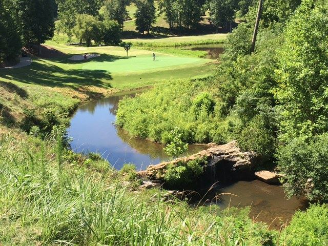 No. 12 is the signature hole at Cider Ridge. The par-3 is guarded by a creek spills over a dramatic waterfall when the water is running. (Photo by Al Muskewitz)