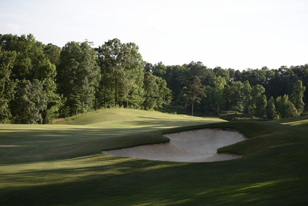 A deep fairway bunker awaits players who don't hit it straight or long enough off the 18th tee. (Photo by Sandra Howell)