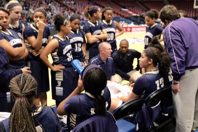 Ryan Chambless (C) plots strategy with his Jacksonville girls basketball team during a timeout in last year's Class 4A Final Four in Birmingham. On the cover, Chambless makes a point to boys scorer Cam Horton during a game at Lincoln. (File photos)