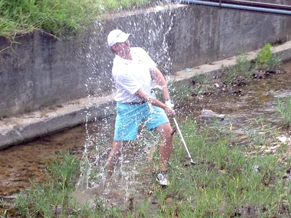 Andrew Brooks splashes out of the hazard on No. 15 at Cane Creek Golf Course in Friday's Calhoun County Championship. He made a double bogey on the hole and shot 74 in the round.