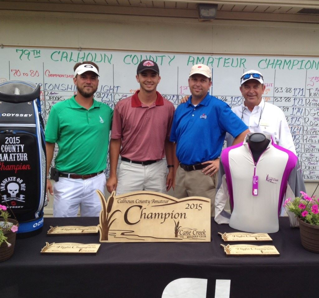 Kyle Turner (second from left) won the third flight after posting a final-round 76.