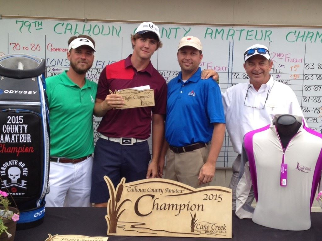 Dakota Yawn (second from left) came out of a three-way playoff to win the first flight.