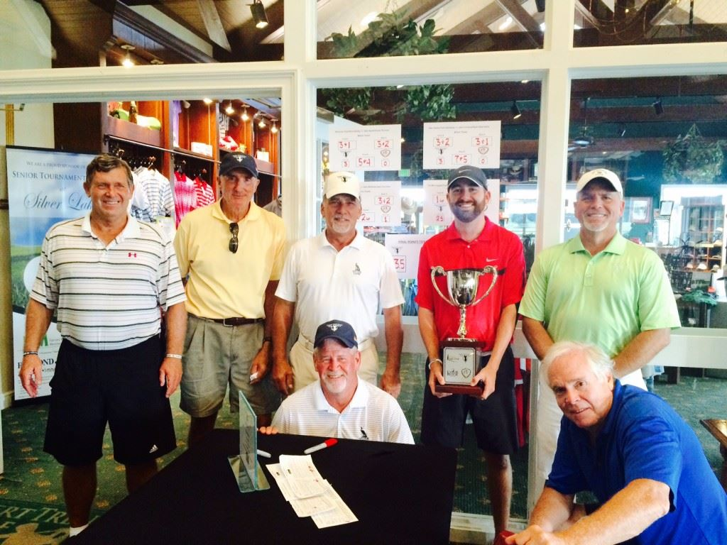 Silver Lakes captain Brennan Clay holds the EA Sports Today Cup flanked by teammates (standing from left) Steve Bailey, Tim MacTaggart, Alan Darnall and Bobby Luttrell and (kneeling from left) Ken Green and Ted Klimasewski. Not pictured Tom Ganshaw.