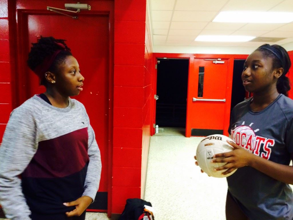 Saks senior Jordan Briskey (R) talks with her sister and Donoho junior high coach Destinee after the Lady Wildcats defeated the Lady Falcons in straight sets to win the Saks Invitational Saturday.