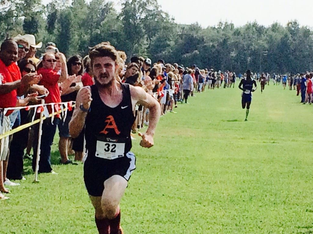 Alexandria's Lane Trapp pushes towards the finish for the boys wins in the Waffle House/Yellow Jackets Invitational Saturday at Oxford Lake. He ran seven seconds faster than he did finishing third on this course in the County Meet last fall.