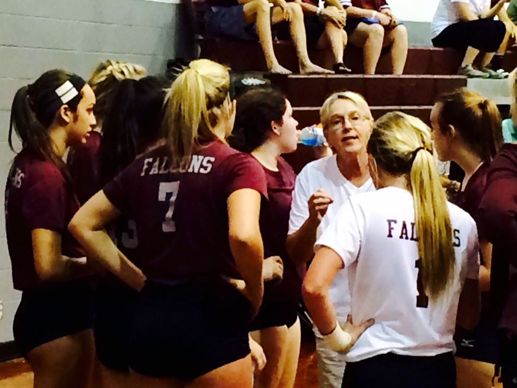 Donoho volleyball coach Janice Slay makes a point to her players during a time out in Saturday's Donoho Classic title match with Meek. Below, Pleasant Valley huddles after winning the tournament's Silver Bracket.