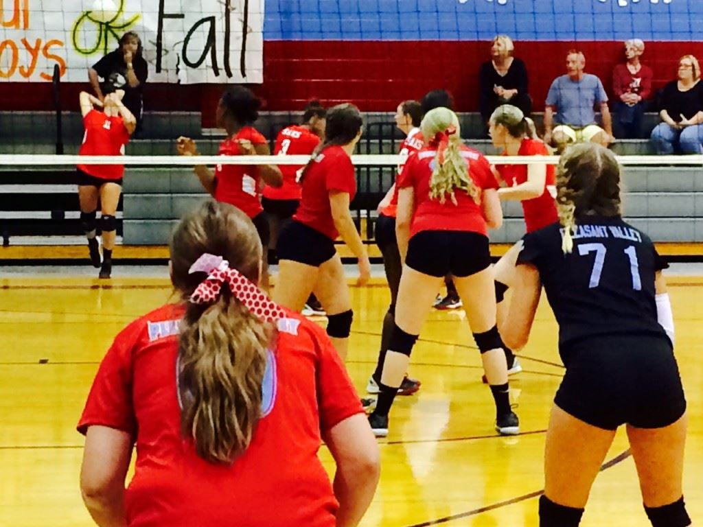 Pleasant Valley players Madison Bentley (71) and Taylor Williams prepare to receive the serve of Saks' Jaelyn Wilson during Saturday's title match.