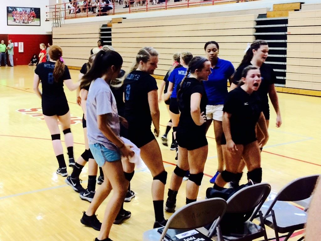 The White Plains volleyball team breaks the huddle during a recent match.