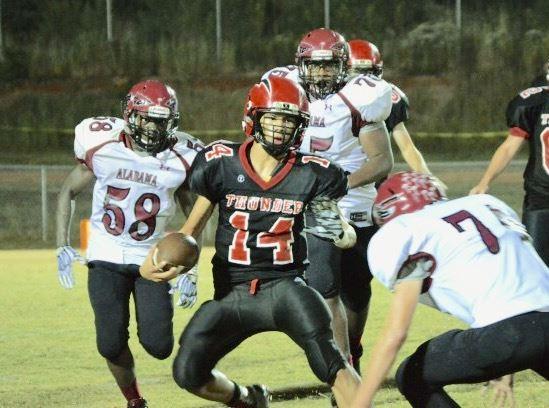 JCA quarterback Jayden Mitchell (14) appears surrounded by the ASD defense Friday night. (Photo by Prime Time Prepz/www.primetimeprepz.com)