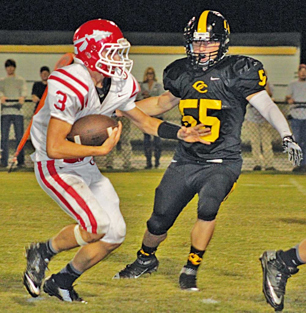 Ohatchee running back Austin Tucker (3) looks to lose the pursuit of Cherokee County linebacker Austin Hightower. (Photo by Shannon Fagan)