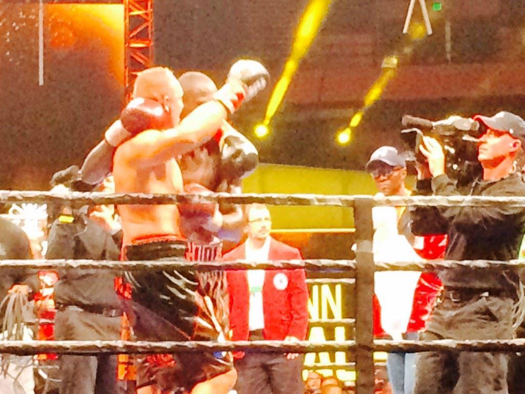 Deontay Wilder respectfully walks Johann Duhaupas (L) around the ring after Wilder won their hard-fought WBC heavyweight title fight Saturday night.