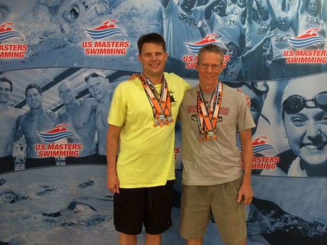 Anniston swimmers Johnnie Pearson (L) and Bob Couch display their medals after strong showings in last month's U.S. Masters National Championships.