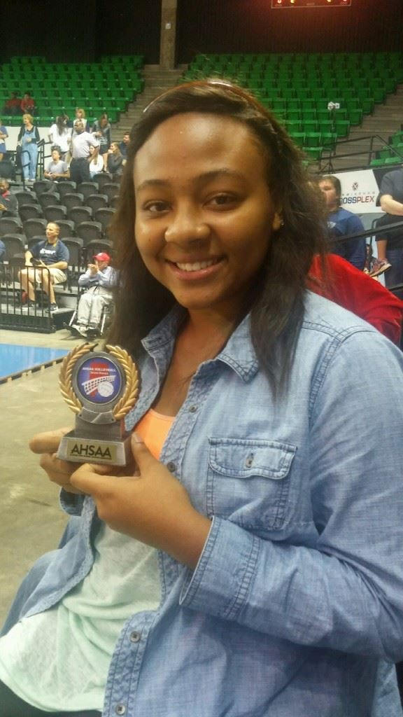 Jacksonville's Aniyah Robinson holds her Class 4A All-Tournament team award. Robinson was one of only five players across seven classifications whose teams didn't play in a championship match to make an All-Tournament team.