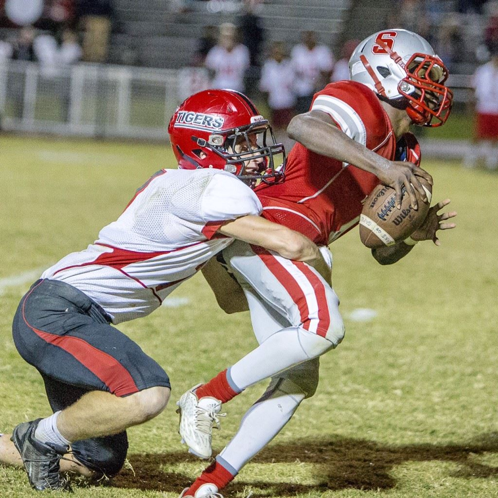 Cleburne County safety Trevor Houston wraps up Saks quarterback Quin Smith on the Wildcats' final play to secure the Tigers' region-title-clinching victory. (Photo by Jonathan Fordham)