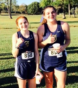 Two-time County girls champion Rebecca Hearn (L) and Jacksonville teammate Victoria Ashby enjoy some down time after the race.