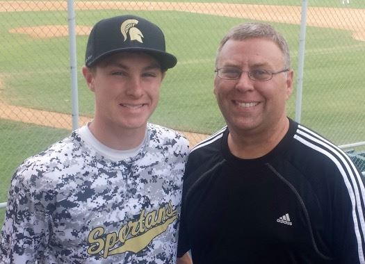 Father and son Mark (R) and Cade Gossett have turned a hobby in the basement into a bat production business.