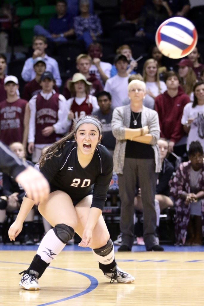 Donoho's Kayla Wallace reacts to the difficulty of getting to a ball during Thursday's Class 1A title match with Meek. (Photo by Kristen Stringer/Krisp Pics Photography)