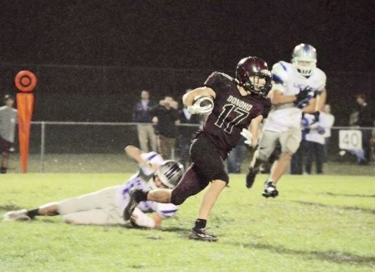 Donoho's Mitchell Baker breaks away from a Victory Christian defender Friday night. The Falcons fell 21-13 as Victory remained undefeated. (Photo by PrimeTimePrepz/www.primetimeprepz.com)