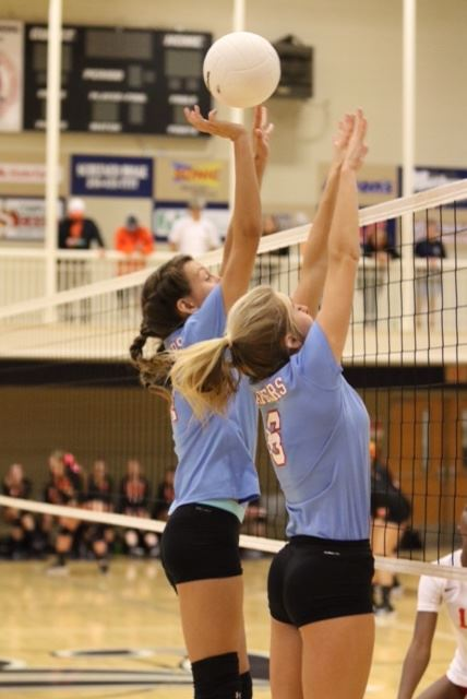 Pleasant Valley's Mikayla Kendrick and Leah Johnson (6) line up on one of the 17 blocks the Lady Raiders had in their match with Saks. (Photo by Kristen Stringer/Krisp Pics Photography)