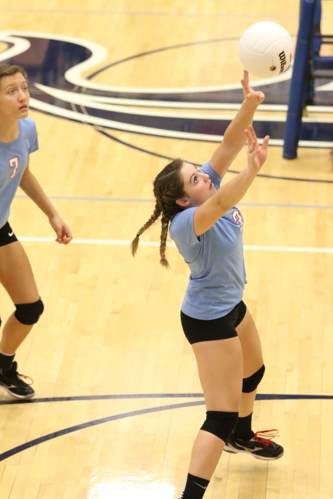 Anna Bryant sets up one of her 24 assists in Pleasant Valley's semifinals victory over Saks. (Photo by Kristen Stringer/Krisp Pics Photography)