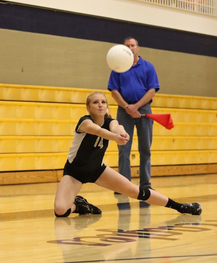 Taylor Ellison keeps the ball alive in Oxford's semifinal victory over Alexandria. (Photo by Kristen Stringer/Krisp Pics Photography)