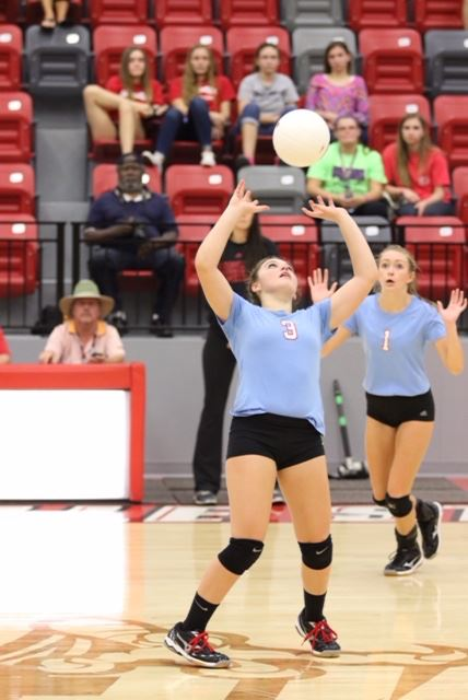 Pleasant Valley's Anna Bryant (3) sets up a play at the net while teammate Leah Johnson gets in position. (Photo by Kristen Stringer/Krisp Pics Photography)