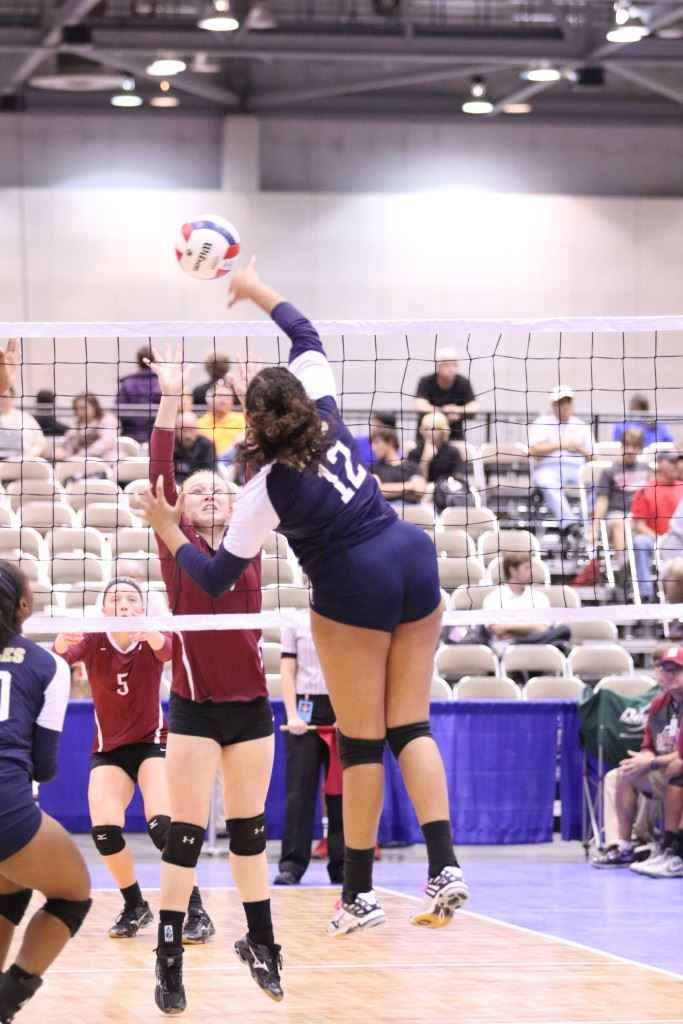 Jacksonville's Sierra Stone goes high to put away a shot against Deshler. (Photo by Kristen Stringer/Krisp Pics Photography)