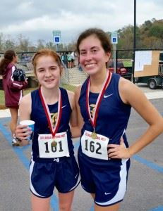 Race winner Rebecca Hearn (L) and Mary Shelton were Jacksonville's top two finishers in their sectional race.
