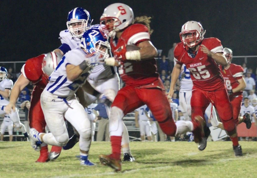 Bruising Saks running back Calvin Figueroa tries to get past West Limestone defender Coleton Smith during Thursday night's 4A playoff game. Figueroa rushed for more than 2,100 yards this season. (Photo by Ocala Honeycutt)