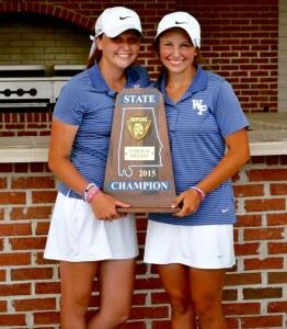 Layne Dyar (R) and her younger sister Hanna hold the state championship trophy White Plains' girls golf team won last spring.