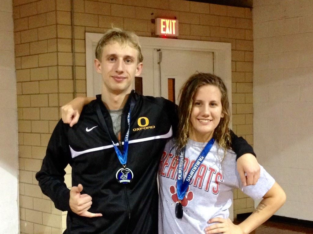 Oxford's Colton Smith (L) and Weaver's Lucia Balma were the high-point scorers in Thursday night's Calhoun County Swimming Championships.