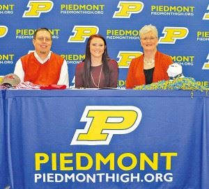 Torrie Roberts (center) and her family are all smiles after the Piedmont shortstop signed to play softball at Jacksonville State on Thursday. (Photo courtesy of Shannon Fagan)