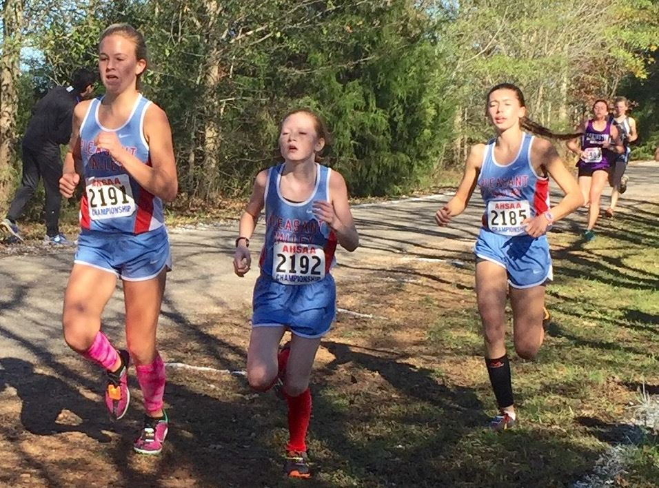 Pleasant Valley runners (from left) Emma Hood, Trinity Roberts and Juliana Ballew form a tight pack early in the Class 3A girls race Saturday. The tight grouping was the key to the Lady Raiders' success. (Photo courtesy of Tara Hood)