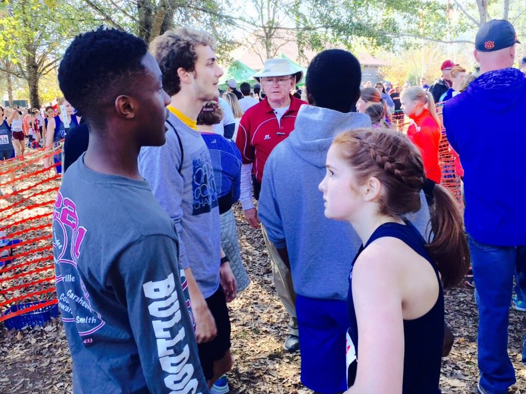 Calhoun County champions Zebedee Lunsford (L) and Rebecca Hearn talk about their respective races at Saturday's state cross country meet.