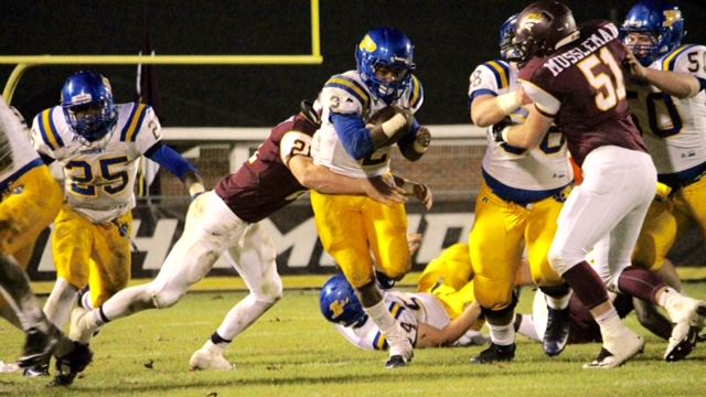 Piedmont running back Darnell Jackson bursts through the hole on his way to another big gain Friday night against Madison Academy. (Photo by Kirk Keener)