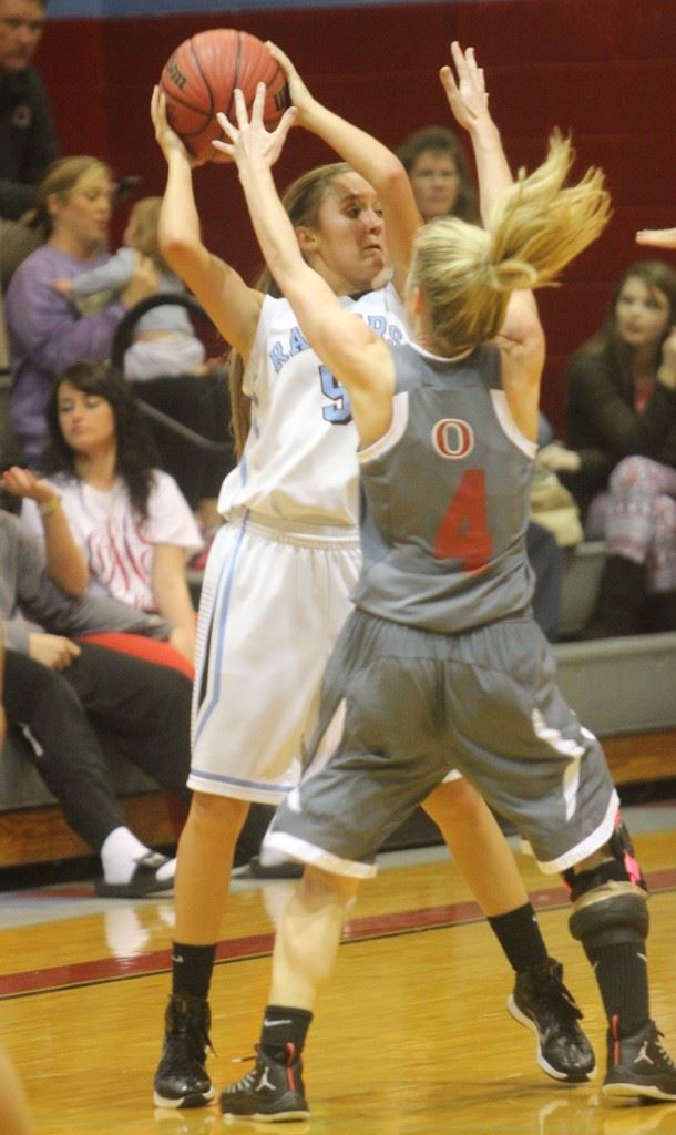 Ohatchee's Hannah Howell (4) plays some tight defense on Pleasant Valley's Atleigh Brannon. The Indians kept Brannon in check for three quarters, before she broke loose in the fourth. (Photo by Krista Walker)