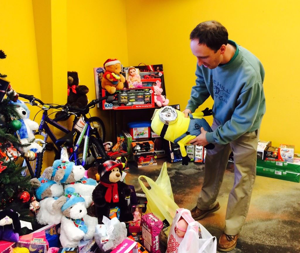 Pine Hill pro Cory Etter puts another donated toy under the tree as he prepares for Saturday's Toys for Kids Classic.