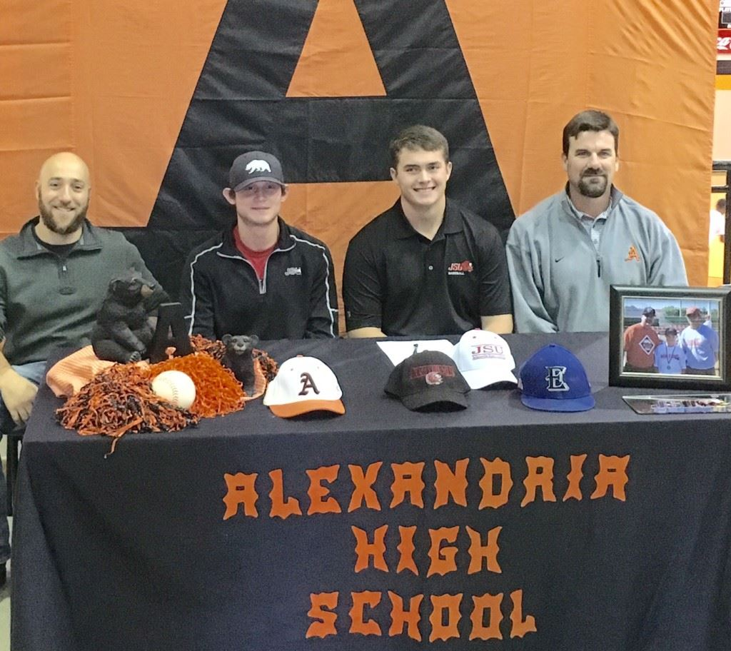 Alexandria pitcher Cody Dodd (third from left) sits with some of his baseball influences during his signing party Friday. From left, Excel Baseball co-founder Josh Beshears, former Alexandria and soon-to-be JSU teammate Dalton Cobb and Alexandria baseball coach Andy Shaw. On the cover, Dodd celebrates his signing with friends.