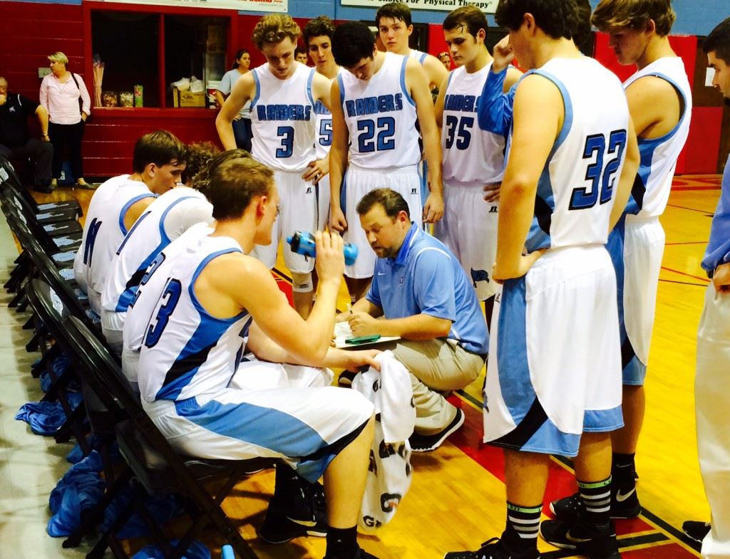 Ryan McCoy (center) has Pleasant Valley 2-0 in its area after Friday's win over Piedmont.