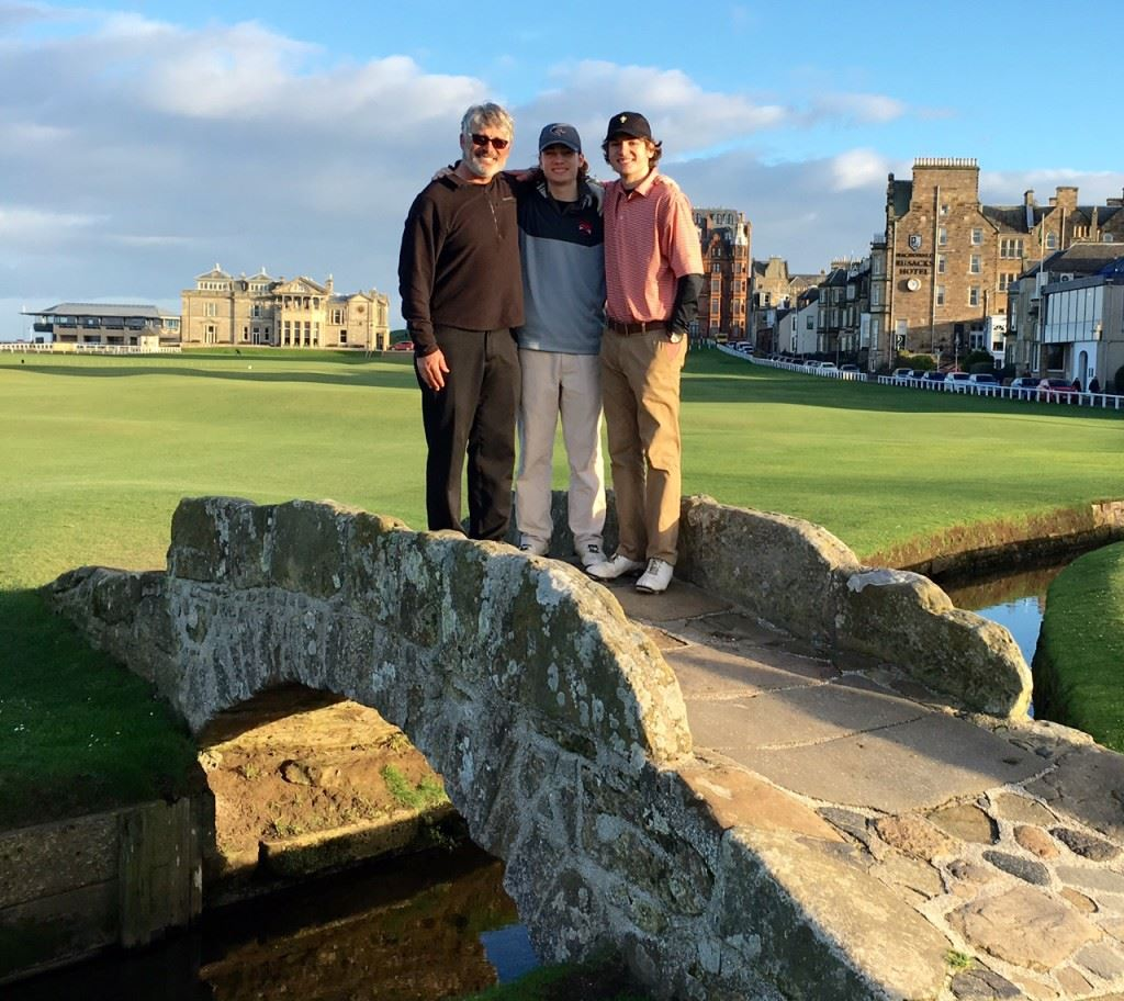 Anniston optometrist Rob Svensen and his sons Jack (center) and Ross pause as they cross the famous Swilcan Bridge on the Old Course at St. Andrews. On the cover, the Svensens huddle up on the first tee. Below, the group walks into the sunset at the end of a golf trip of a lifetime. (Photos by Rob Svensen)