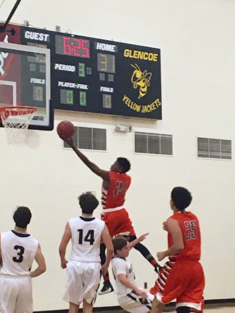 Alexandria's Caleb Young (24) drives to the basket against Glencoe. (Photo by Jason Katz)