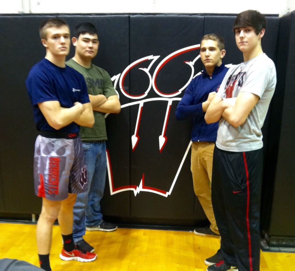 Weaver senior wrestlers (from left) Brannon Bellar, Chase Rodgers, Collin Allison and Tyler Johnson await the final home match of their careers. On the cover future Marines Bellar, Rodgers and Allison are flanked by their Marine recruiters. (Photos by Christy Souder)