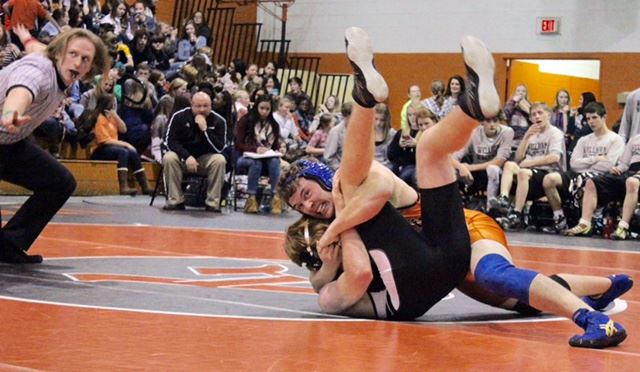 Alexandria senior Phillip Gaddy (orange) is just about to put the wraps on his pin of Wellborn's Dalton Epps  in Wednesday's match. (Photo by Angela Trapp)
