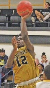 Oxford guard Eugene Leonard scored a double-double against Cherokee County. On the cover, Warriors guard Joel Wester makes his move to the basket. (Photos by Shannon Fagan)