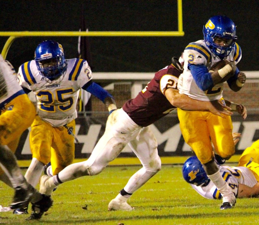 Neonta Alexander (25) played both ways for Piedmont; he's a finalist for Class 3A Lineman of the Year for his play as a linebacker. On the cover, Piedmont quarterback Taylor Hayes (11) is a finalist for 3A Back of the Year.