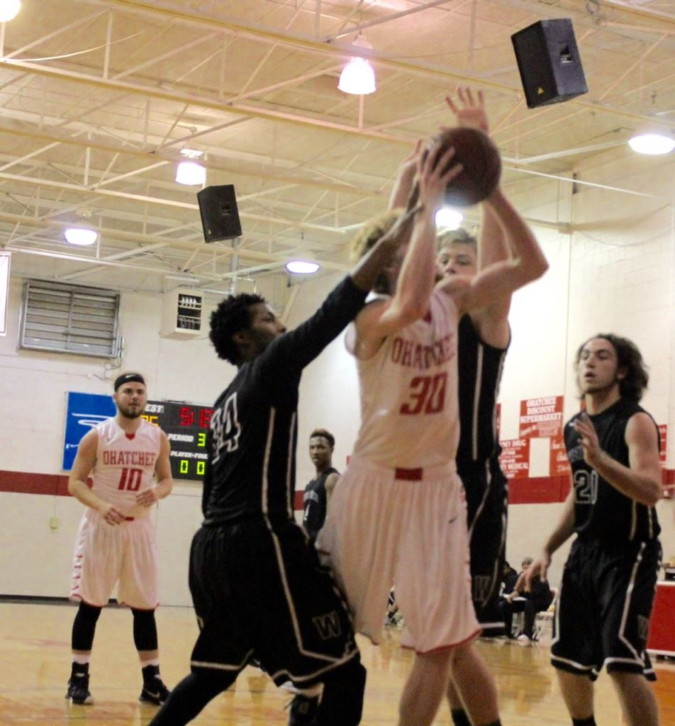 Ohatchee's Brian Jennings (30) draws a lot of attention from Wellborn defenders as he makes a move under the basket Monday. (Photo by Carrie Howell)