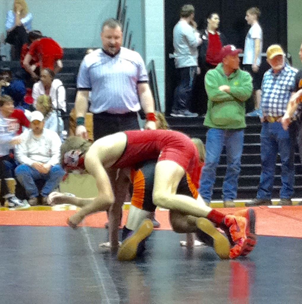 Weaver's once-beaten Nick Souder gets on top of Alexandria's Lane Trapp in their 115 championship match Tuesday. (Photo by Christy Souder)