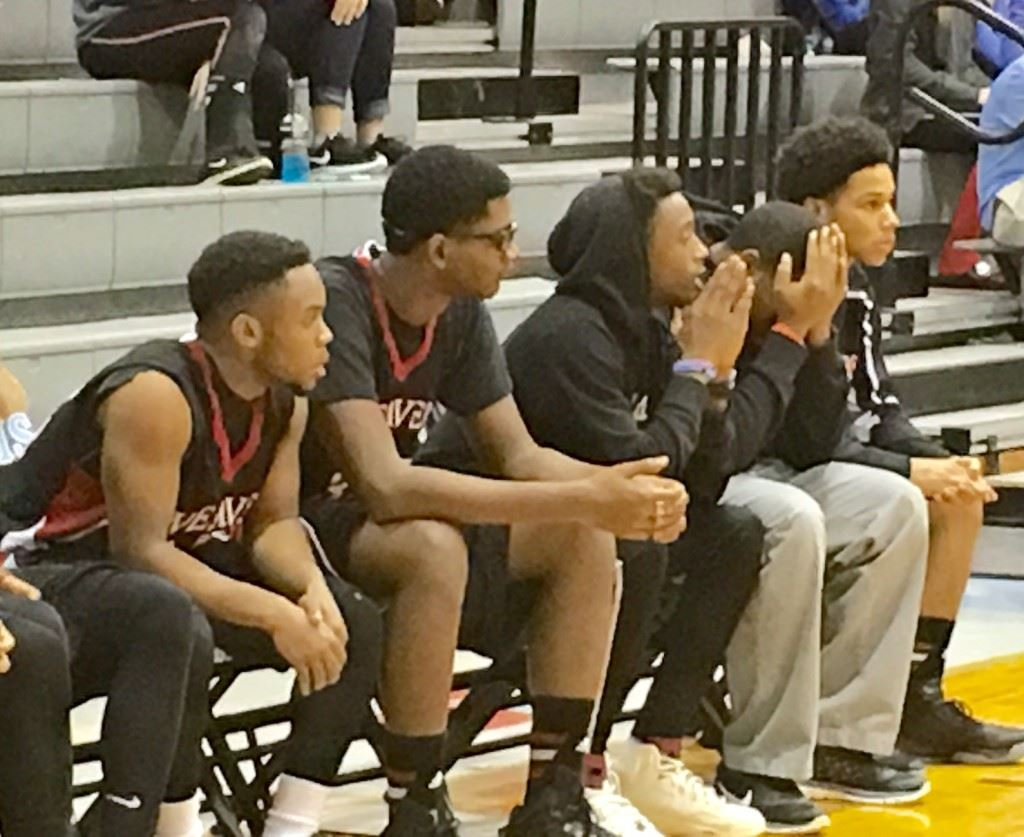 Weaver senior guard Jalen Heath (center) watches the action unfold in Thursday's game with Pleasant Valley from a coach's perspective as he awaits medical clearance to return to action.