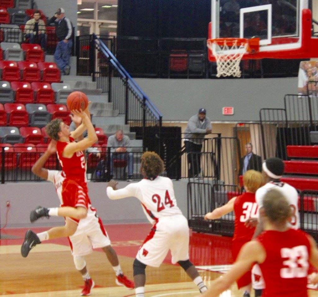 Ohatchee's Austin Tucker soars through the air towards the basket in Tuesday night's Calhoun County Tournament game with Weaver. (Photo by Carrie Howell)