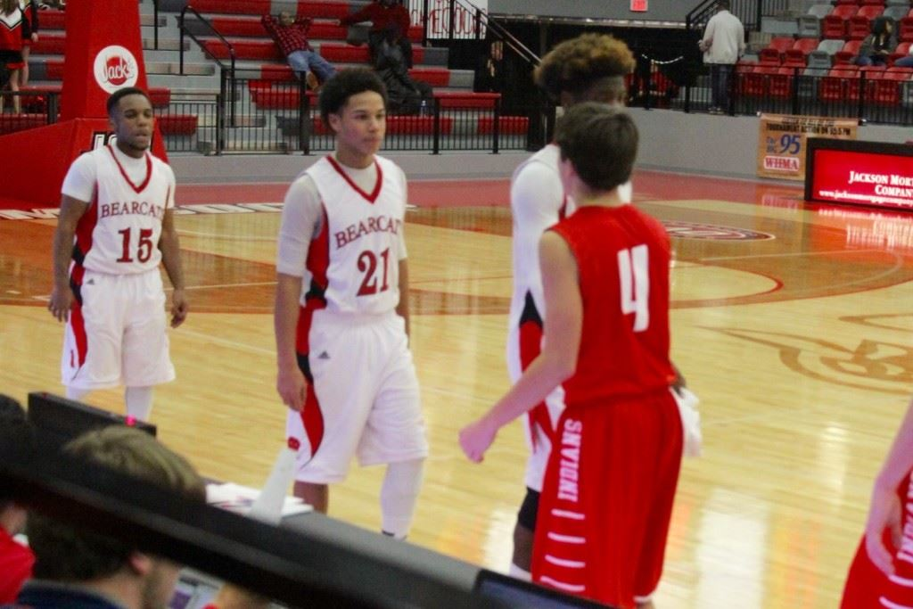 Weaver's Maurice Goodman (21) is approached by Ohatchee's Ben Glass (4) in the post-game handshake after Tuesday night's game. Goodman played a big role in the Bearcats' victory. (Photo by Carrie Howell)
